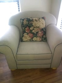gray fabric sofa chair with floral throw pillow Charlotte, 28212