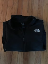 black the North Face zip-up hoodie