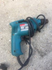 blue and black corded power tool Maurice, 70555