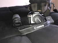 Black canon eos dslr camera 751 mi
