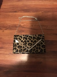 Black and white leopard clutch bag, never used