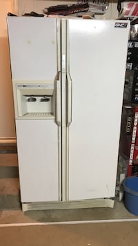 white GNC side-by-side refrigerator with dispenser