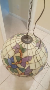 white, purple, and green Tiffany glass chandelier