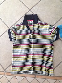4 Lacoste golf shirts size 4 - $30 each or $100 for all 4 Toronto, M8Z 3Z7