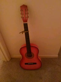 Pink classical guitar Houston, 77345