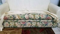 white, green, and pink floral loveseat  Oviedo