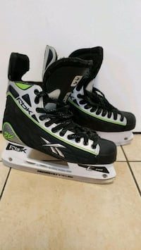 pair of black-and-white Bauer ice skates Montreal, H1S 1T5