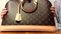 brown and black Louis Vuitton leather tote bag Riverside