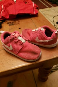 pair of red Nike running shoes Louisville, 40211