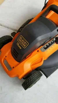 orange and black Black & Decker power tool