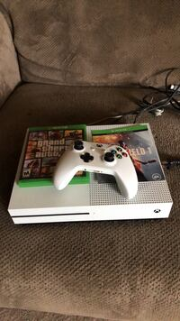 white Xbox One console with controller and game cases Nashville, 37072