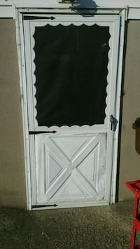 Storm Door. wind damage. Includes screen and glass 45248