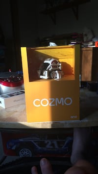white and black Cozmo toy with box
