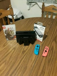black Nintendo Switch console with game