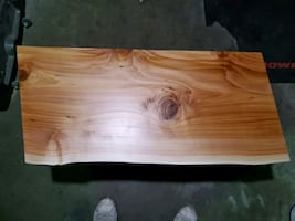Wooded coffee table. Brushed stainless legs