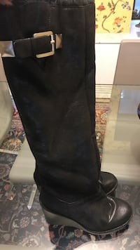 pair of black leather round-toe wedge knee-high engineer boots