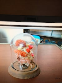 A Deer & Flowers Encased With Glass Dome