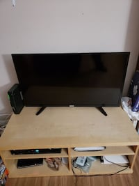 VERY NICE LIGHT COLORED WOODEN TV STAND