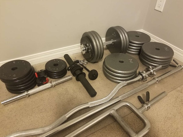 black and gray dumbbells and barbell