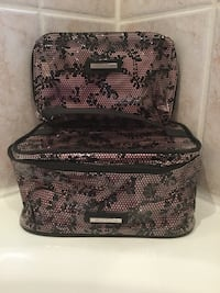 Black and pink floral avon 2-piece toiletry and makeup zip bag. New! Brampton, L6R 3P4