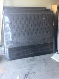 Queen size headboard in grey fabric tufted with crystals Vaughan