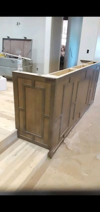 Cabinet and staircase builder .  Norman