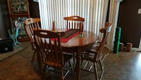 round brown wooden table with four chairs dining s New Iberia, 70560