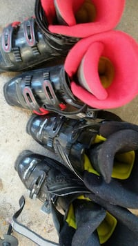 two pairs of black-red-and-gray and black-gray-and-yellow ski boots
