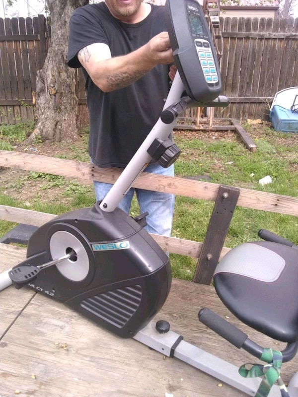 black and gray stationary bike 0