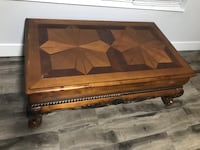 brown wooden framed glass top coffee table Surrey, V3S 5E3