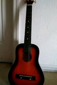 red and black acoustic guitar Poinciana