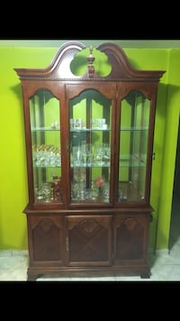 Brown wooden framed glass display cabinet Miami, 33175