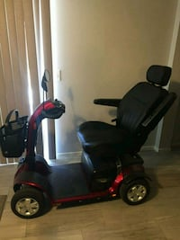 black and red mobility scooter 2173 mi