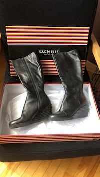 pair of black leather boots Laval, H7L 4C1