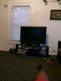 black flat screen TV with TV stand Clinton, 28328