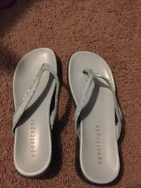 pair of gray Apostrophe t-strap sandals