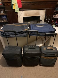 3 carry on bags with wheels and 2 garment bags  Crestwood, 63126