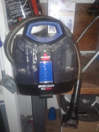 black and blue Bissell upright vacuum cleaner