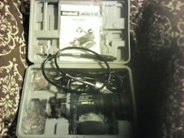 black and gray corded power tool not sold