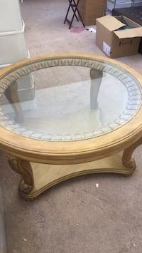 round brown wooden framed glass top coffee table Antioch, 94531
