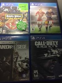 four assorted PS4 game cases Toronto, M3M 1G4