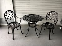 Round black metal table with two chairs patio set Saugus, 01906