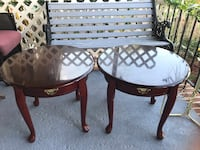 two round brown wooden side tables Baltimore, 21225