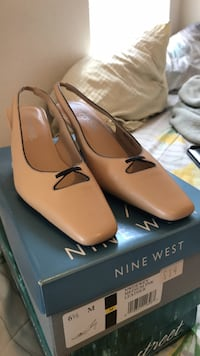 pair of brown leather pointed-toe flats 302 mi