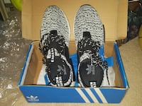 pair of white-and-black Adidas sneakers