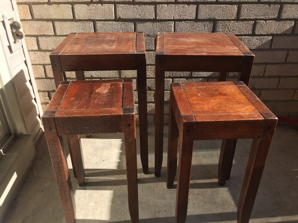 Four brown wooden side tables