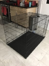 Dog crate 42inch. Like new. 2 doors and easily folds. Divider included Rockville, 20853