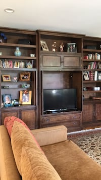 flat screen television with brown wooden TV hutch Calabasas, 91302