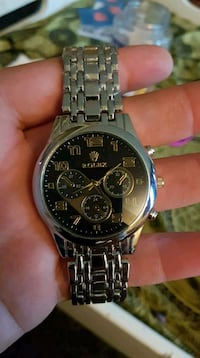round silver chronograph watch with link bracelet Edmonton, T6B 1A2