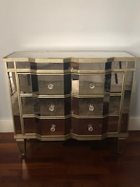 Mirrored dresser from horchow. damage on corner and on 1 drawer as pictured in detail. Gold mirror sideboard